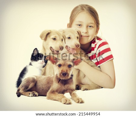 child and a group of pets  - stock photo
