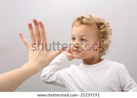 Child and adult clap hands. - stock photo