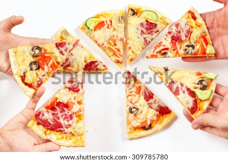 Child and adult hands snapping up pieces of a pizza - stock photo