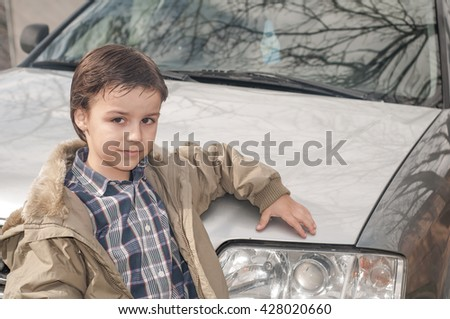 child and car