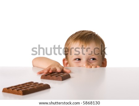 Child and chocolate - stock photo