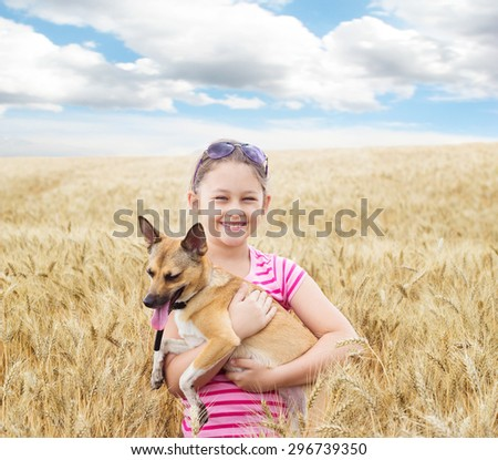 child and dog and cereal field - stock photo