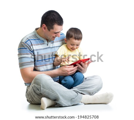 child and father looking to play and read tablet computer - stock photo