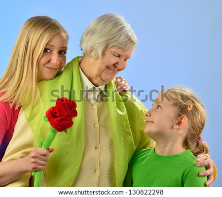Child and grandchild give a gift their grandmother, expressing his care and love for her. MANY OTHER PHOTOS FROM THIS SERIES IN MY PORTFOLIO. - stock photo