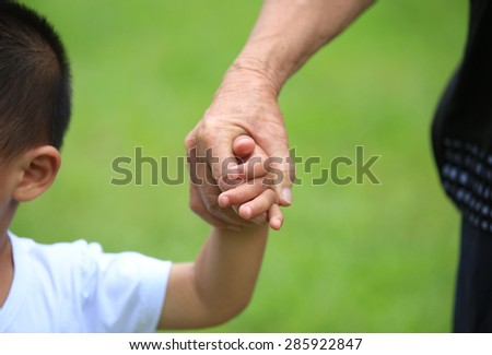 Child and grandma holding hands