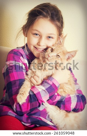 child and kitten, maine coon - stock photo
