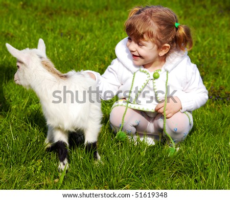 child and little goat