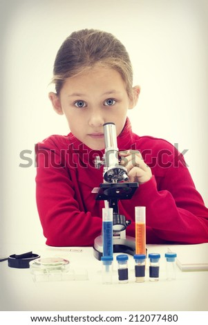 child and microscope - stock photo