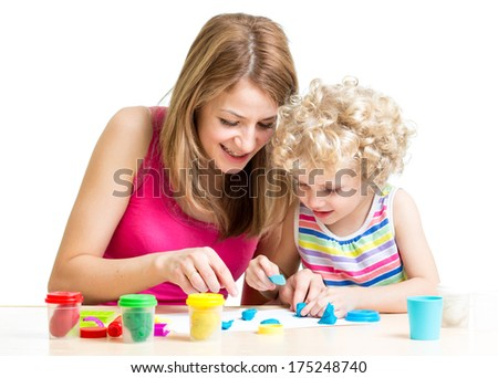 child and mother play colorful clay toy - stock photo