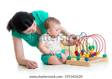child and mother play with color educational toy - stock photo
