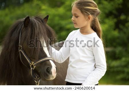 child and pony - stock photo