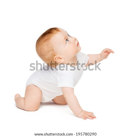 child and toddler concept - crawling curious baby looking up - stock photo