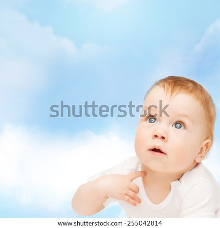 child and toddler concept - curious baby looking up - stock photo