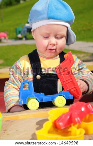 child and toy car outdoor - stock photo
