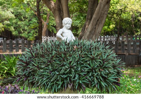 Child angel statue in a park - stock photo