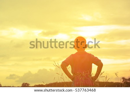 Child asian looking sunshine view.Child lonely and sad with mountain view in holiday.