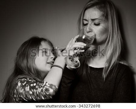 Child ask that mother stopped drinking alcohol. - stock photo