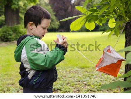 Child at at control point at orienteering course. - stock photo