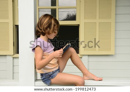 Child at home reading book of children stories