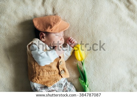 Child baby boy with tulip. Mothers day