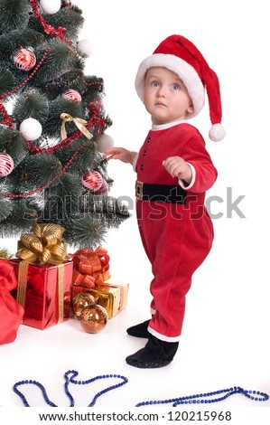 child baby in red Santa's hat