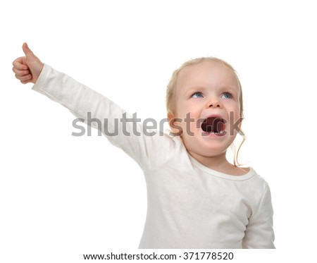 Child baby toddler happy looking up yelling screaming with hand thumb up sign isolated on a white background - stock photo