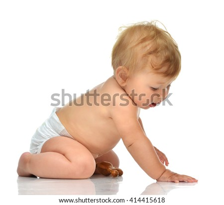 Child baby toddler sitting facing backwards from the back rear view looking at the corner isolated on a white background - stock photo
