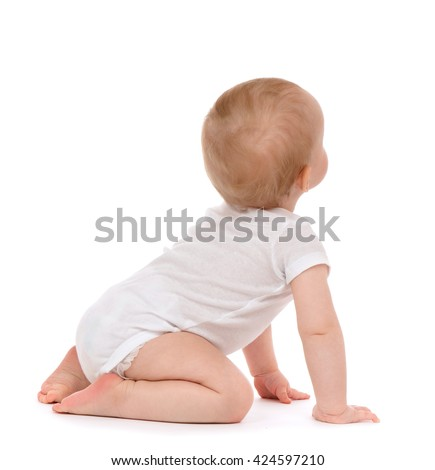 Child baby toddler sitting facing backwards from the back rear view looking at the corner isolated on a white background