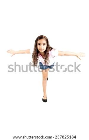 child balancing on one leg . - stock photo
