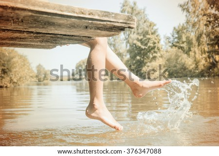 child bathing in the river - stock photo