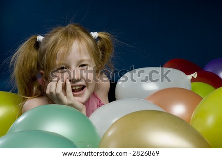 Child between the balloons