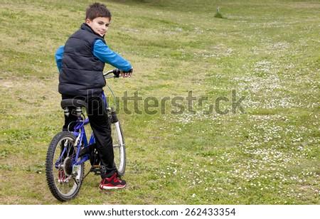 child biking - stock photo