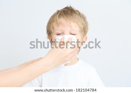 child blowing his nose, illness - stock photo