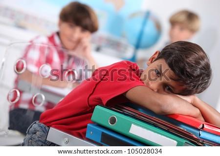Child bored at school - stock photo