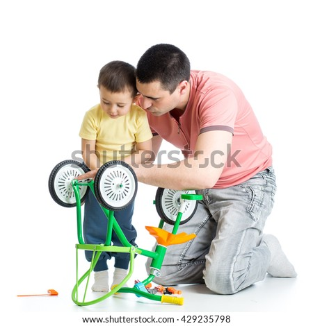 Child boy and daddy fixing bisycle