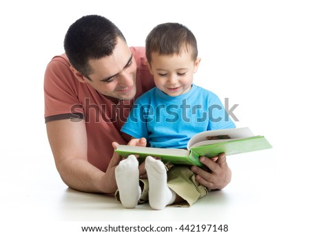child boy and his father read a book on floor at home - stock photo