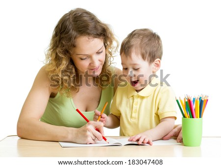 child boy and mother draw with colorful pencils - stock photo