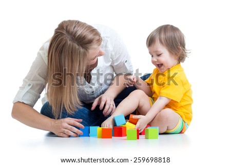 child boy and mother play together with construction set toys - stock photo