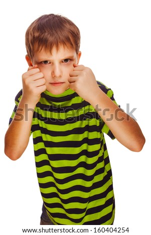 child boy blond bully angry bad aggressive fights in striped green shirt isolated on white background  - stock photo