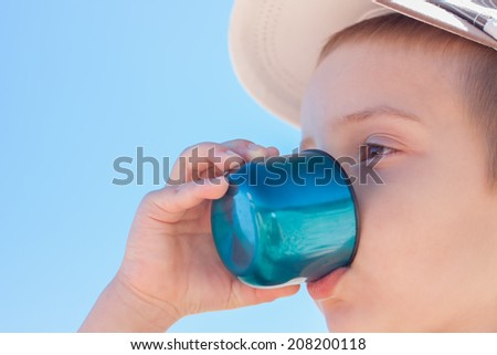 child boy drink water close up outdoor - stock photo