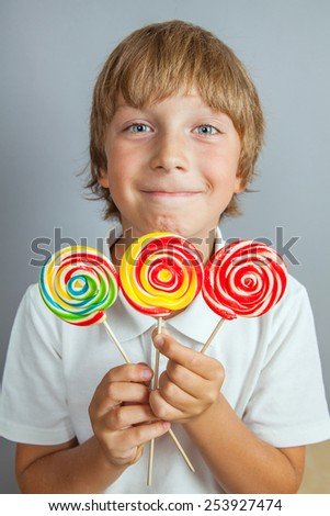 child boy eating lollipop isolated - stock photo