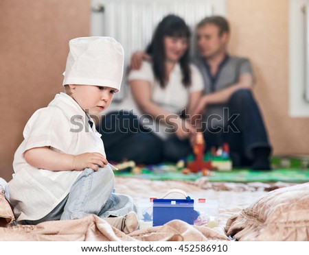 Child boy playing doctor home