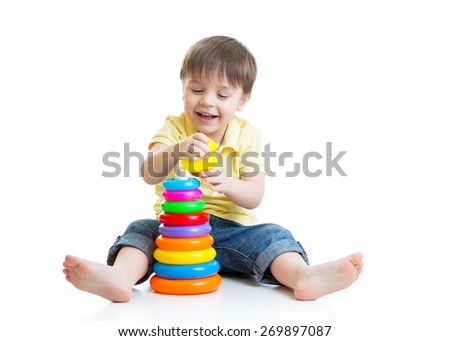 child boy playing with color pyramid toy