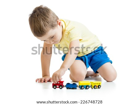 child boy playing with toys isolated on white - stock photo