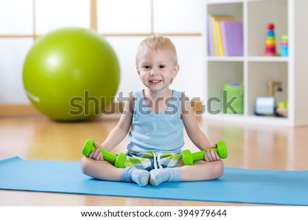 Child boy ready to fitness exercises - stock photo