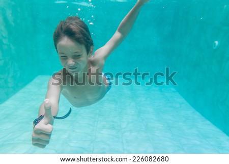 child boy swimming underwater - stock photo