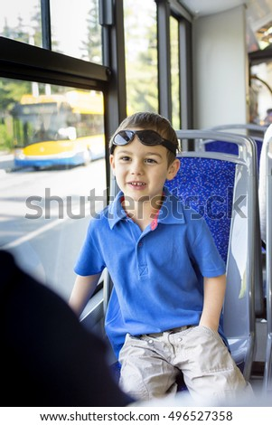 Child boy traveling on a city  public transport bus in.