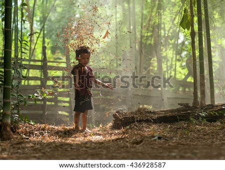 Child boy tribal playing in smog of forest