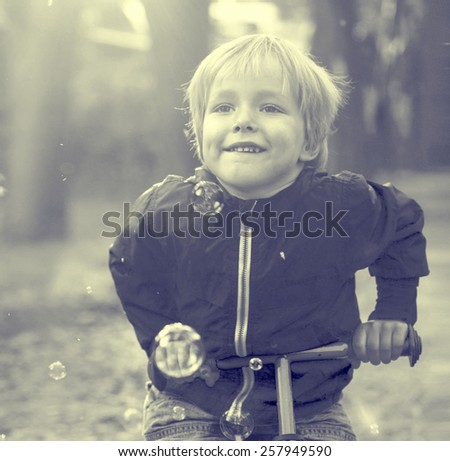 Child boy with bike nature - stock photo