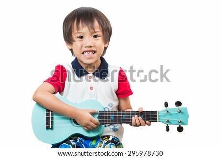 child boy with guitar.ukulele guitar,isolated - stock photo